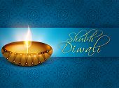 Indian festival of lights, Shubh Diwali (Happy Diwali) greeting card with illuminated oil lit lamp on floral decorated blue background.