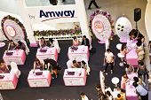 Hostesses From Amway Are Advising Customers How To Use Their Products