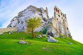 The Ruins Of Old Medieval Castle On Rocks. Surrealistic Landscape.