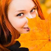 Red-haired Girl And Maple Leaf