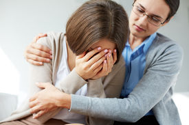 stock photo of compassion  - Image of compassionate psychiatrist comforting her crying patient - JPG