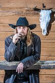 picture of bandit  - Portrait of a gruff looking old west bandit - JPG