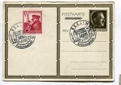 BERLIN, GERMANY, 20 APRIL 1939: German postcard canceled with two stamps celebrating 50th birthday of Adolf Hitler. One of postage stamps shows Hitler visiting his native town, Braunau.