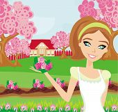 Beautiful Woman Plant Flowers In The Garden