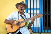 HAVANA, CUBA - FEBRUARY 25, 2014: Street musician playing traditional cuban music on an acoustic gui