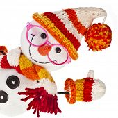 happy snowman spectacled in knitted hat and scarf and mittens isolated on white background