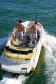 White Motorboat with Yellow Trim