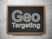 Finance concept: Geo Targeting on chalkboard background