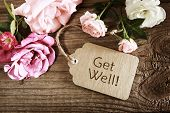foto of get well soon  - Get well message tag with roses wooden table - JPG