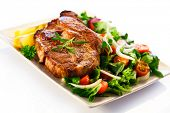 stock photo of fried onion  - Grilled steak and vegetables - JPG