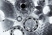 aerospace titanium and steel gears and ball-bearings, against brushed aluminum