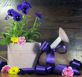 Happy Easter Chocolate Easter Egg With Luxury Satin Purple Ribbon Bow And Old Pink Watering Can With