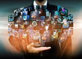 Businessman Holding Reaching Images Streaming In Hands .financial And Technologies Concepts