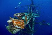 pic of bottomless  - Free diver exploring the ship wreck in tropical sea - JPG