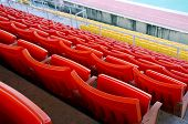 image of grandstand  - Red chair on Grandstand in the Stadium - JPG