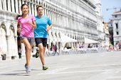 foto of piazza  - Running runner couple jogging in Venice - JPG