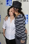 WEST HOLLYWOOD - MAR 15: Sara Gilbert, Linda Perry at An Evening with Women kick-off concert present