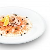 Fresh delishous salmon carpaccio served with parmesan cheese, capers and lemon. Isolated on white