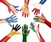 stock photo of yugoslavia  - Diverse Hands In a Circle Painted With National Flags - JPG