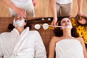 Couple With Face Mask In Spa Centre