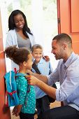 stock photo of goodbye  - Father Saying Goodbye To Children As They Leave For School - JPG