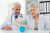 pic of stress-ball  - Male doctor with senior patient using stress buster ball at the medical office - JPG