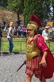 Actor Depicting A Roman Legionary For Tourists Near The Colosseum. Rome, Italy