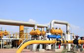stock photo of oilfield  - In oil field there is oil pipeline and oilfield equipment at work - JPG