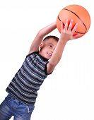 Boy, Basketball Player Makes A Throw With A Ball