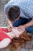 stock photo of respiration  - Adult man doing artificial respiration young woman - JPG