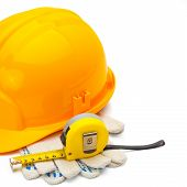 Construction Helmet With Measure Tape And Gloves On White Background