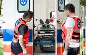 Woman Lying On Stretcher In Ambulance