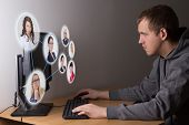 Social Media Concept - Young Man Using A Computer