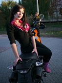 Beautiful Young Brunette On A Motorcycle.