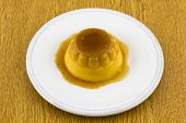 Creme Caramel Dessert Or Flan On White Dish