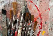 paint brushes on paint splatter wood background