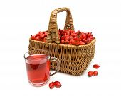 Basket With Berries Of Wild Rose And A Drink In A Glass Mug On A White Background