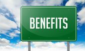 Benefits on Highway Signpost.