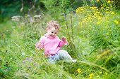Funny Adorable Baby Girl Walking In The Garden