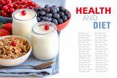 Jars Of Fresh Natural Yogurt, Berries And Cereals