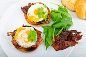 picture of benediction  - Eggs benedict with bacon and spinach on white plate - JPG