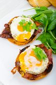 pic of benediction  - Eggs benedict with bacon and spinach on white plate - JPG