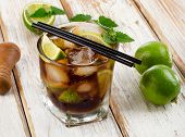 Cuba Libre Drink With Mint On A Wooden Table