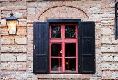 picture of jalousie  - Retro window with black jalousie outdoor and old brich wall - JPG
