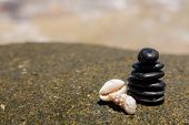 zen stones jy wooden banch on the beach near sea. Outdoor
