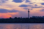 Tv Tower On Galati Romania In The Sunset Mirroring The Danube River