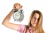 Serious Girl Holding A Clock Over White Background