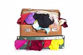 Old Brown and the green suitcase full of clothes isolated before white background