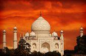 Retro Filtered Sunset Over Taj Mahal, India.