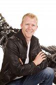 Man In Black Jacket Motorcycle Behind Him Smiling